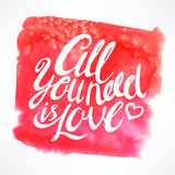 All you need is Love. Hand-drawn quote on watercolor background Royalty Free Stock Photos