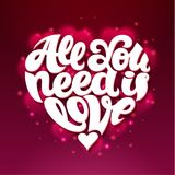 All You Need Is Love lettering design shaped in heart. Royalty Free Stock Photography