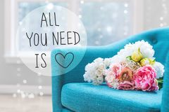 All You Need Is Love message with flower bouquets with chair royalty free stock photography