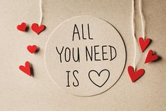 All You Need Is Love message with small hearts stock photos