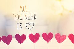 All you Need Is Love message with small red hearts stock photo