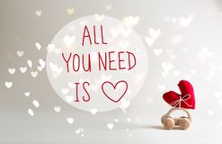 All You Need Is Love message with toy car carrying a heart. Cushion royalty free stock image
