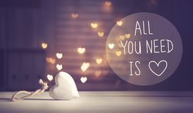 All You Need Is Love message with a white heart Stock Photo