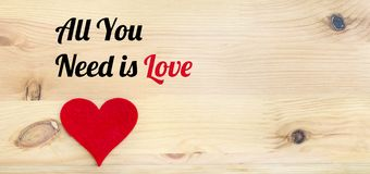 All You Need is Love Text and Red Heart. On a Wooden Background Royalty Free Stock Images
