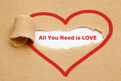 All You Need is Love Torn Paper Royalty Free Stock Photography