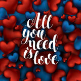 All you need is love. Vector text on red and blue background. Hand drawn inscription, calligraphic design. Lettering for invitation and greeting card, prints stock illustration