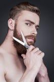 Alla barba o non alla barba Fotografia Stock
