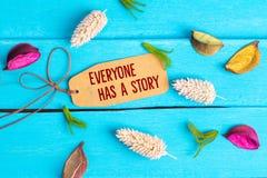 Alla har en berättelsetext på pappers- etikett arkivbilder