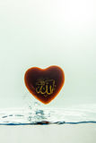 `allah` god of Islam with   symbol   Water splash with bubbles of air,  on the white background.  Stock Photo