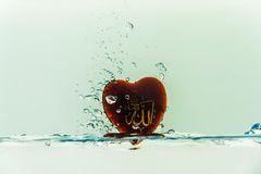 `allah` god of Islam with symbol Water splash with bubbles of air, on the white background stock illustration