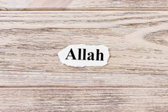 ALLAH of the word on paper. concept. Words of ALLAH on a wooden background.  Stock Images