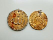 Allah is written on golden pendants stock photography