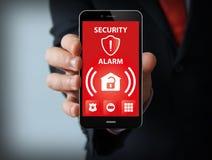 Allarme di sicurezza su uno smartphone Fotografia Stock