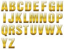 allcaps字母表成斜面金黄 图库摄影