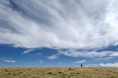 Alleen onder de wolken in Parang Stock Foto