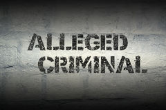 Alleged criminal gr. Alleged criminal stencil print on the grunge white brick wall Royalty Free Stock Images