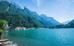 Alleghe, Belluno,italy: a charming mountain village located in a unique natural setting overlooking its fascinating lake , in the. Geographic heart of the royalty free stock photography