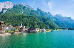 Alleghe, Belluno,italy: a charming mountain village located in a unique natural setting overlooking its fascinating lake , in the. Geographic heart of the Royalty Free Stock Images