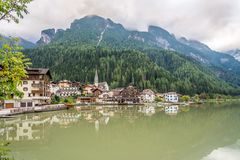 Alleghe town with lake in in Italy Dolomites Royalty Free Stock Images