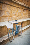 Alleging bike against a wall Tuscan monument Royalty Free Stock Image