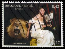 Allegorical image of Belgium. Belgium - CIRCA 2000: A stamp printed in Belgium shows a painting by J. Charlier is a belgian artist, allegorical image of Belgium stock photo