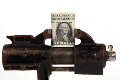 Allegory of the global financial crisis. U.S. dollars in the grip of economic crisis, on a white background Stock Photo