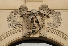 Allegory of Philosophy. A stucco mask on the facade of the Municipal House in Prague, Czech Republic royalty free stock images