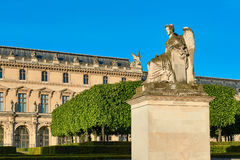 Allegory statue of Victorious France and Louvre museum. Royalty Free Stock Images