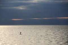 Alleine in Meer Stockfoto