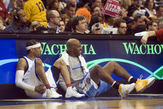 Allen Iverson. (3) and Denver's Chauncey Billups wait to return in the second quarter of 12/7/2009 game at Philadelphia Stock Images