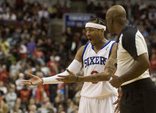 Allen Iverson. Sixers Allen Iverson pleads his case with offical Haywoode Workman after being charged with a fould in the first quarter of 12/7/2009 game Royalty Free Stock Images