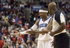 Allen Iverson. Sixers Allen Iverson pleads his case with offical Haywoode Workman after being charged with a fould in the first quarter of 12/7/2009 game Royalty Free Stock Photography