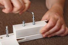 Allen-Möbelschlüssel in der Hand Stockfotografie
