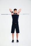 Allenamento atletico dell'uomo con il bilanciere Fotografie Stock