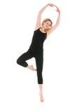Allenamento di giovane donna dell'acrobata Fotografia Stock