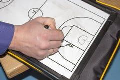 Allenatore di pallacanestro della compressa Fotografie Stock Libere da Diritti