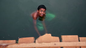 ALLEPPEY, INDIA - MARCH 2013: Boy bathing in canal Royalty Free Stock Photo