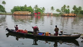 ALLEPPEY, INDIA - MARCH 2013: Local people travelling in boat Stock Images
