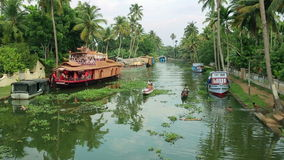 ALLEPPEY, INDIA - MARCH 2013: Local people travelling in boat Stock Photo