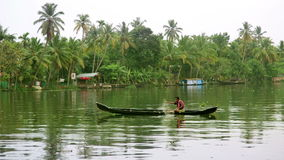 ALLEPPEY, INDIA - MARCH 2013: Man fishing on canal Stock Photo