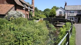 Allerford Somerset England UK with pack horse bridge stock video