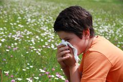 Allergic boy to pollen and flowers Stock Photos