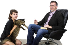 Allergic Dad Hates Pet Cat. Allergic father dislikes daughters pet cat because of fur on jacket stock images