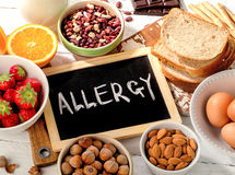 Allergic food on wooden background. Food allergy. Allergic food on wooden background royalty free stock photo