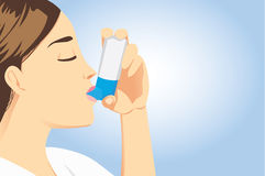 Allergic patient use asthma inhalers Stock Photo