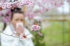 Allergic reactions to spring flowers Royalty Free Stock Photo