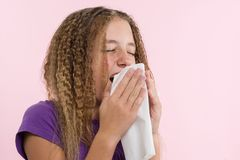 Allergic rhinitis on a summer vacation in a teenage girl`s journey. Royalty Free Stock Photo