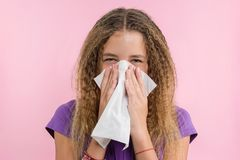 Allergic rhinitis on a summer vacation in a teenage girl`s journey. stock images