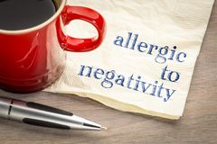 Allergic to negativity note on napkin. Allergic to negativity note - handwriting on a napkin with a cup of coffee royalty free stock images