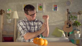 Allergic to oranges.The young man itches. Rejection of oranges and citrus.Young man itching, allergic to oranges stock video footage
